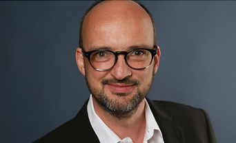 Dominik Grolllmann, Analyst iBusiness